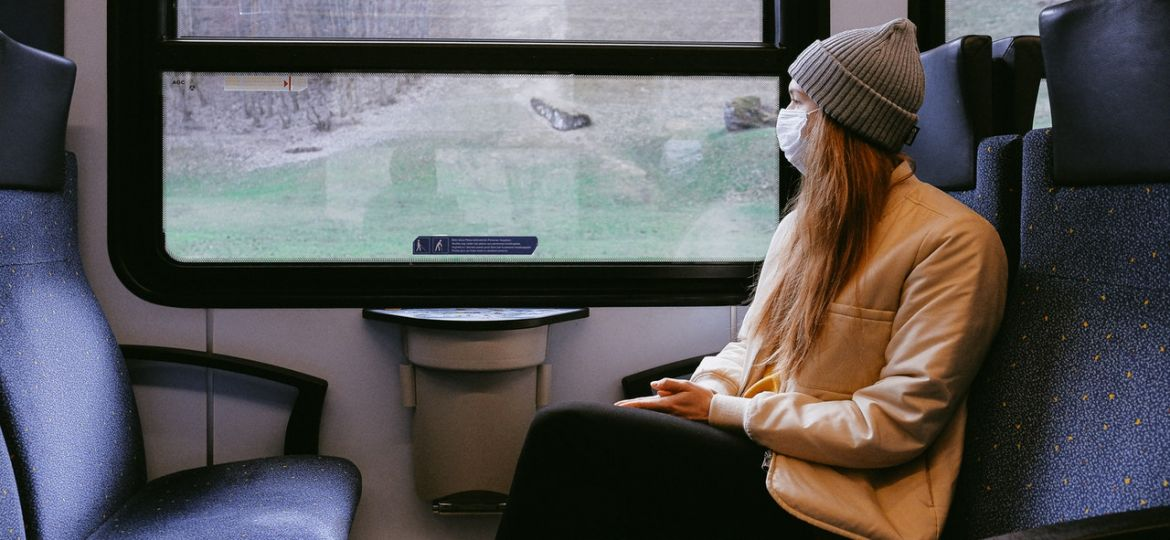 woman-wearing-mask-on-train-3962213